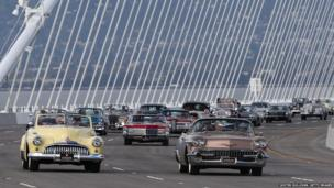 A procession of vintage cars crosses the new eastern span of the San Francisco Oakland Bay Bridge