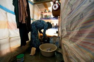Syrian refugee, Khadija Mohammed washes clothes inside her tent, at a temporary refugee camp in the eastern Lebanese town of Faour near the border with Syria, Lebanon.