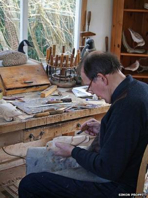 John Davies carving a bird in his workshop