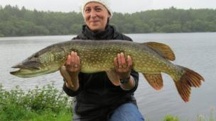 Angela holding a pike fish