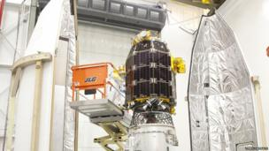 An engineer works on the LADEE device