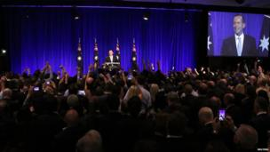 Tony Abbott (C) claims victory during an election night function in Sydney, 7 September