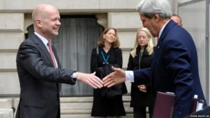 US Secretary of State John Kerry (right) is greeted by Britain's Foreign Secretary William Hague at the Foreign and Commonwealth Office in London