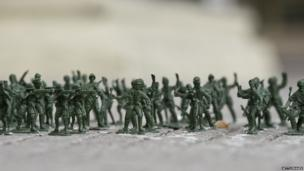 Toy soldiers are displayed on the pavement as part of an art installation in front of the presidential palace in Santiago, on 11 September 2013, during the commemoration of the 40th anniversary of the military coup led by General Augusto Pinochet that deposed President Salvador Allende
