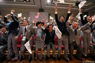 Members of the Tokyo bid committee celebrate as they hear the announcement that Japan will host the 2020 Summer Olympic Games