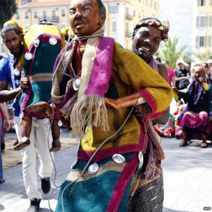 People from Benin prepare to compete in a puppet show in Nice, France (10 September 2013)