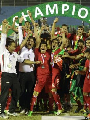 Afghanistan football players celebrate winning the SAFF Championship 2013 trophy after defeating India during the final match in Kathmandu on 11 September 2013.