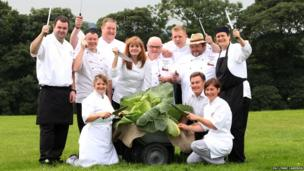 Show Director, Martin Fish (front, second from right) poses with ten chefs and a giant cabbage at the Harrogate Autumn Flower Show in North Yorkshire. Lynne Cameron/PA Wire
