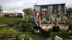 TV gardener Katie Rushmore tours the show gardens as preparations are made for the start of the autumn flower show. Lynne Cameron/PA Wire