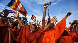 Buddhist monks who are supporters of the Cambodia National Rescue Party (CNRP), react during a protest as party leader Sam Rainsy announces the result of a meeting with Cambodian Prime Minister Hun Sen, at Freedom Park in Phnom Penh.
