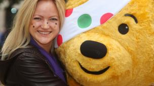 Pudsey bear and a girl with stickers on her face