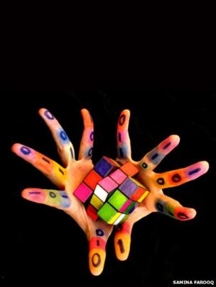 Rubiks cube in hands