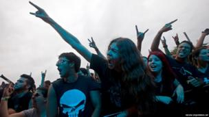 Fans sing along with the Brazilian band Almah