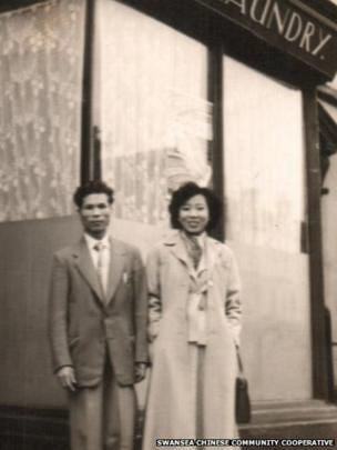 Mr and Mrs Chine with their laundry shop in the 1950s