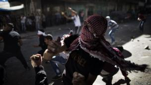 Palestinian stone throwers in Hebron