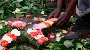 A trader prepares flowers in the shape of a cross for sale outside the City Mortuary, for the victims who were killed during the attack at the Westgate Shopping Centre in Kenya's capital Nairobi, 25 September, 2013.