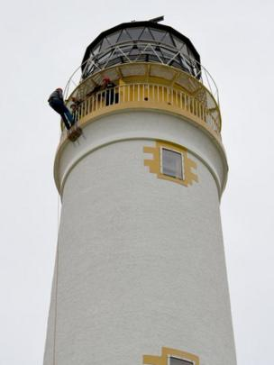 Michael abseils down a lighthouse