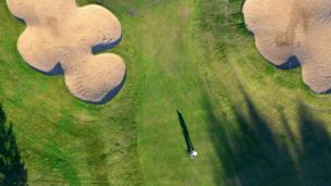 Aerial view of a golfer on a golf course