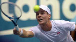 Tomas Berdych of the Czech Republic hits the ball against Gilles Simon of France during the semi-final round of the ATP Thailand Open 2013 tennis tournament in Bangkok