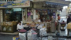 People buying spices at a shop in Damascus, Syria. Photo: Babak