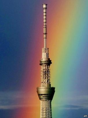 A rainbow is seen behind the world's tallest radio tower, the Tokyo Skytree