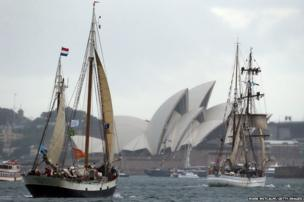 Tall Ships sail towards the Opera House after entering Sydney Harbour in Australia.