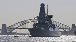 """Britian""""s warships HMS Daring anchors in front of the Harbor Bridge during the International Fleet review in Sydney, Australia, Friday"""