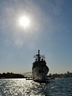 US navy warship, forward-deployed Ticonderoga-class cruiser USS Chosin (CG 65), docks at the Sydney Harbour in front of the Harbour Bridge on October 4, 2013