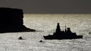 British guided missile destroyer HMS Daring (R) enters Sydney Harbour on October 4, 2013 at the start of the Fleet Review
