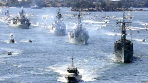 Royal Australian Navy warships led by HMAS Sydney (R) enter Sydney Harbour