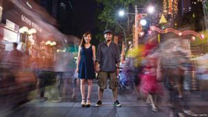 Street photographer Danny Santos and his wife