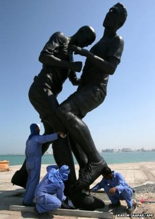 A bronze sculpture the infamous head-butt by French football legend Zinedine Zidane on Italy's Marco Materazzi
