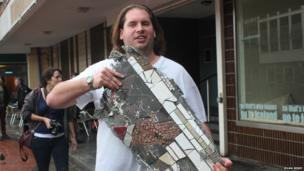Man holding piece of Chartist mural, Newport. Photo: Ieuan Berry