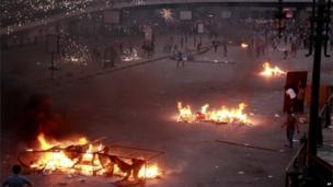 Pro-military crowds and supporters of the former president, Mohammed Morsi, throw rocks, fireworks and firebombs in street battles near Ramsis Square, Cairo, Egypt