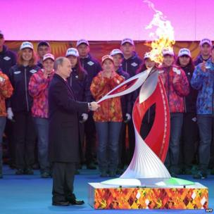 Russian President Vladimir Putin lights a torch during a ceremony in Moscow to mark the start of the Sochi 2014 Winter Olympic torch relay across Russia. (6 October 2013)