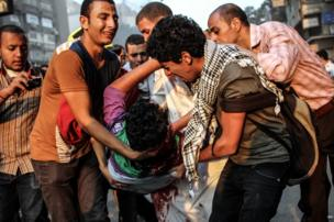 People try to help a protester who was injured during the clashes