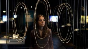 Elpie Psalti, Museum of London exhibition project manager, looks at a selection of bejewelled necklaces and chains included in the Cheapside Hoard