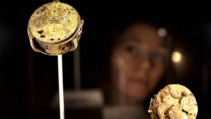 Laura Mitchell, from the Museum of London looks at the gilt brass watch, a piece included in the Cheapside Hoard