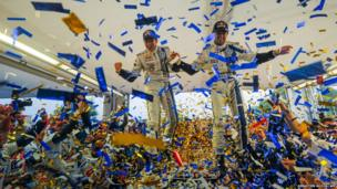 French driver Sebastien Ogier and his co-driver Julien Ingrassia celebrate