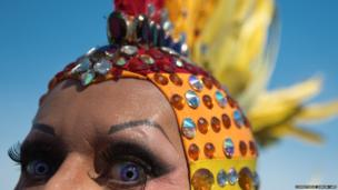 A man poses during the gay pride parade at Copacabana beach in Rio de Janeiro, Brazil