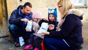 Jamie and Rachel Cheeseman with son Henry, 5, and 3-year-old daughter Daisy enjoying bags of chips at Pack Monday