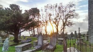 This graveyard view westwards at sunset was taken by the Reverend Roger Pitman from Llangeinor, near Bridgend