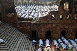 Muslims offer Eid al-Adha prayers at the ruins of the Feroz Shah Kotla mosque in Delhi.
