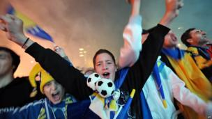 Supporters of Bosnia and Herzegovina's national football team, gather late on October 15, 2013 in Sarajevo