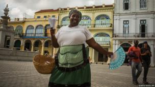 Cuban peanut seller Lysset Perez sings in a street of old Havana, Cuba