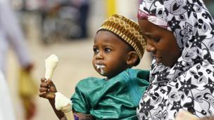 A woman and a child eating ice cream - Abuja, Nigeria - Tuesday 15 October 2013