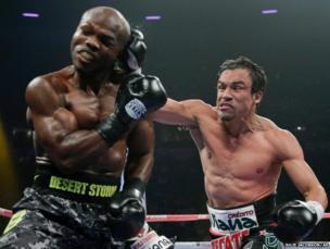 Juan Manuel Marquez lands a punch on Timothy Bradley