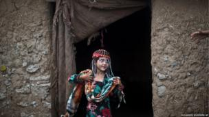 On the outskirts of Islamabad Sameena Hazrat dresses in new clothes to celebrate Eid al-Adha