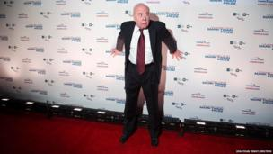 Actor Tim Conway poses for photographers