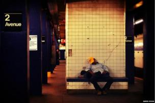 Man asleep on the New York subway